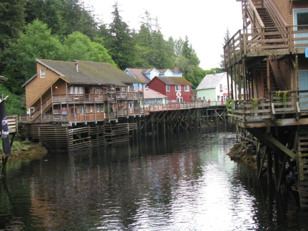 This August 2010 file photo shows a glimpse of Creek Street, a destination dotted with shops, galleries and restaurants, in Ketchikan, Alaska. This southeast Alaska town is now known more for tourism than its once-thriving timber industry. (AP Photo/Becky Bohrer)