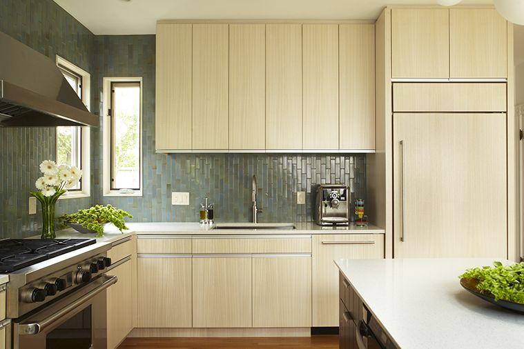 Blonde wood kitchen in a renovated condominium. | Kitchen