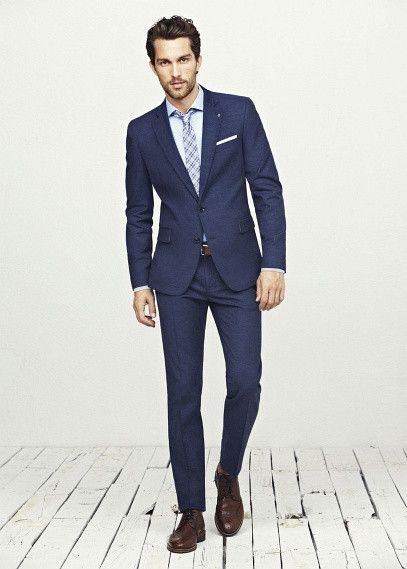 ef84d56bc8772 traje azul marino lino by Mango