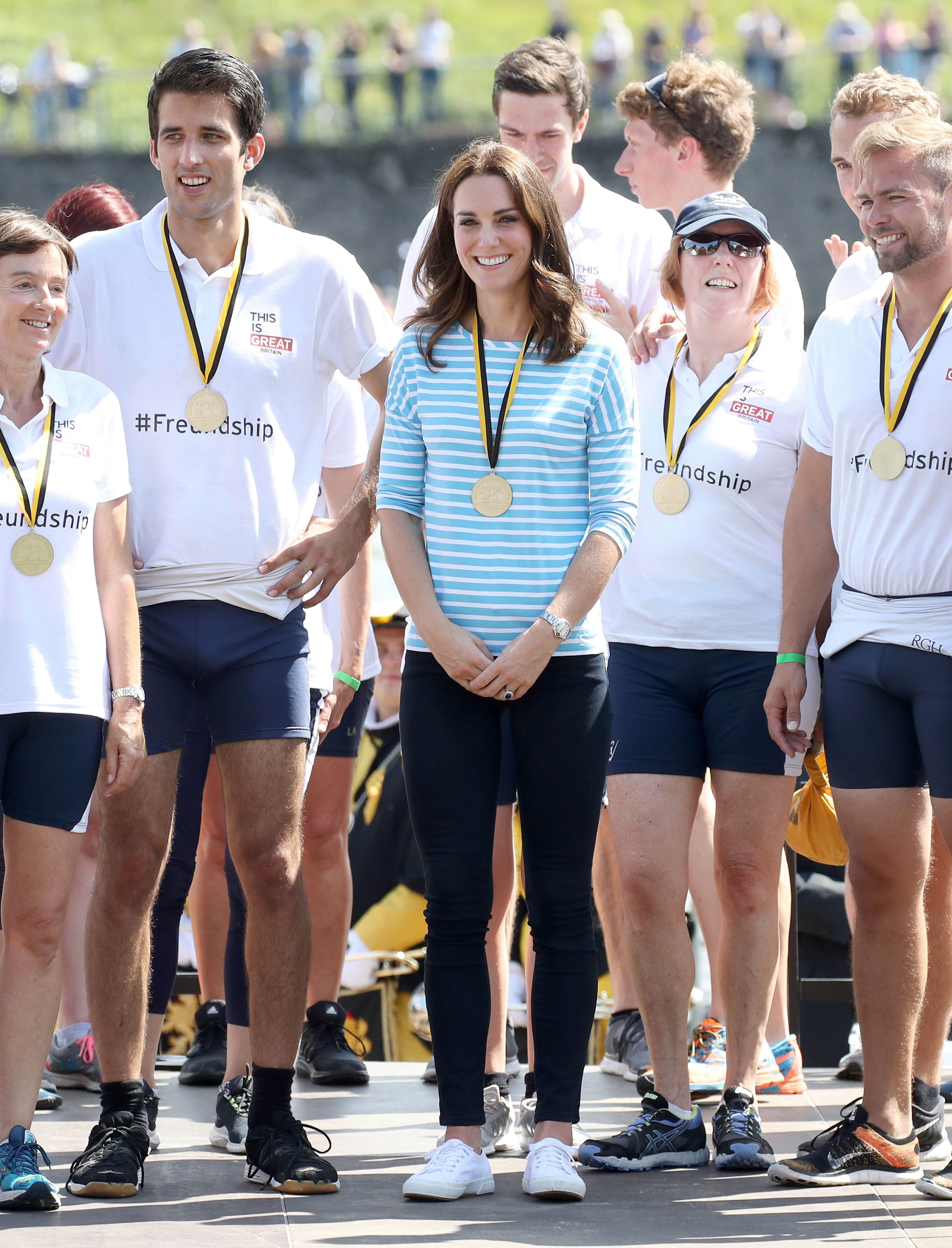 Catherine, Duchess of Cambridge standing with teammates after participating in a rowing race between the twinned town of Cambridge and Heidelberg during an official visit to Poland and Germany on July 20, 2017 in Heidelberg, Germany.