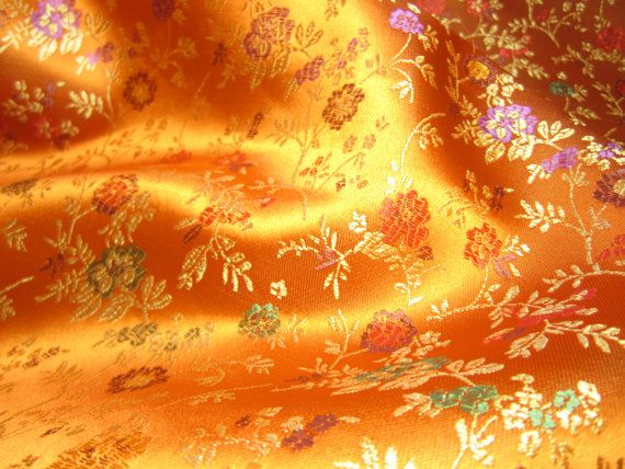51ec2457a ONE yard of Chinese satin brocade fabric in a beautiful vibrant orange with  a floral pattern in red, purple, green and gold. Very luxurious, very
