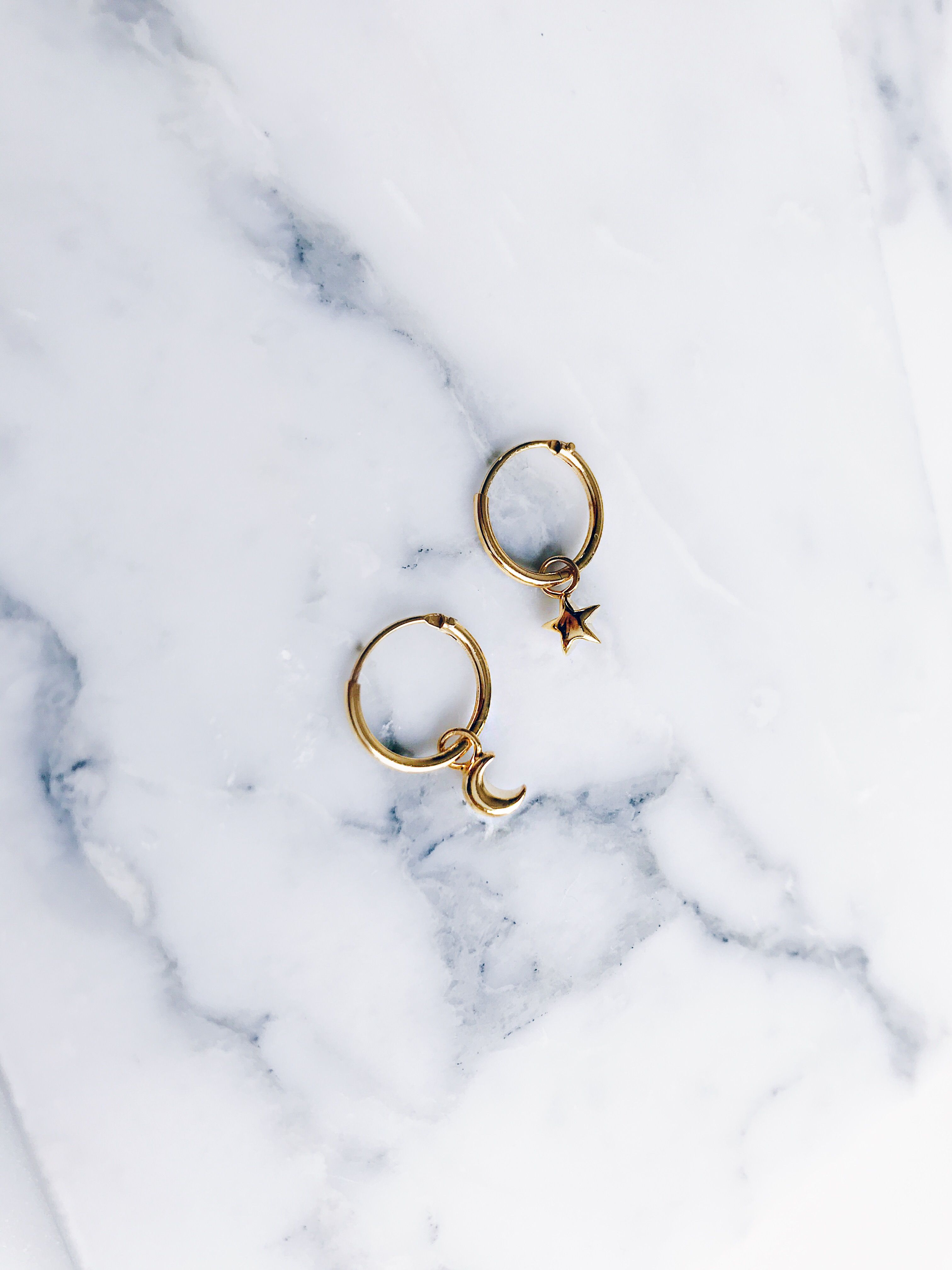 8ae62129c Gorgeous gold star and moon small ear hoops. Beautiful hoop earrings with star  moon design. Clean classic modern hoop earring design that are perfect for  ...