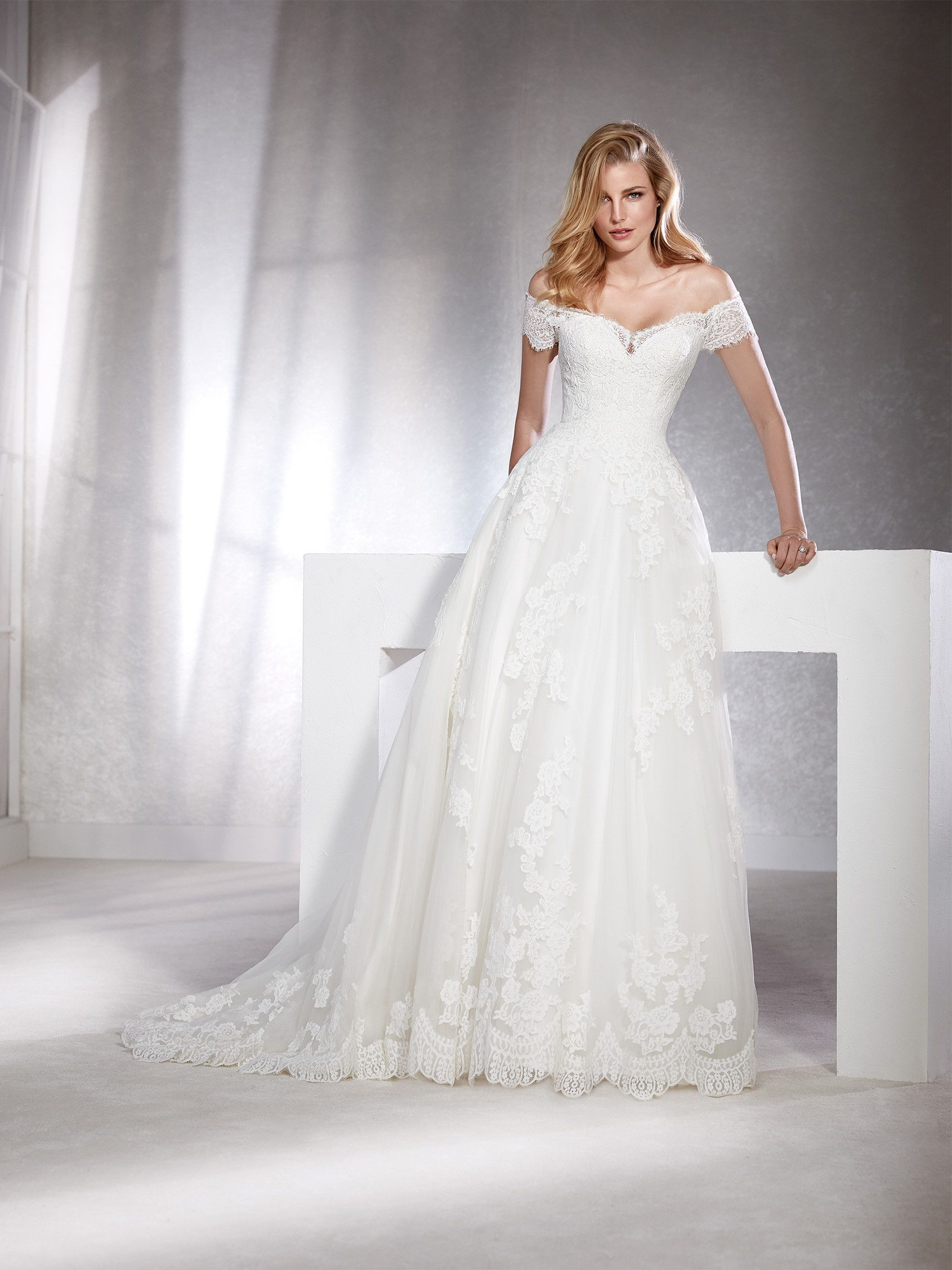 48e691397a35 White One Collection By St. Patrick FABIANA Marvelous wedding dress with an  off-the-shoulder neckline and short sleeves. A lovely design in tulle and  lace ...