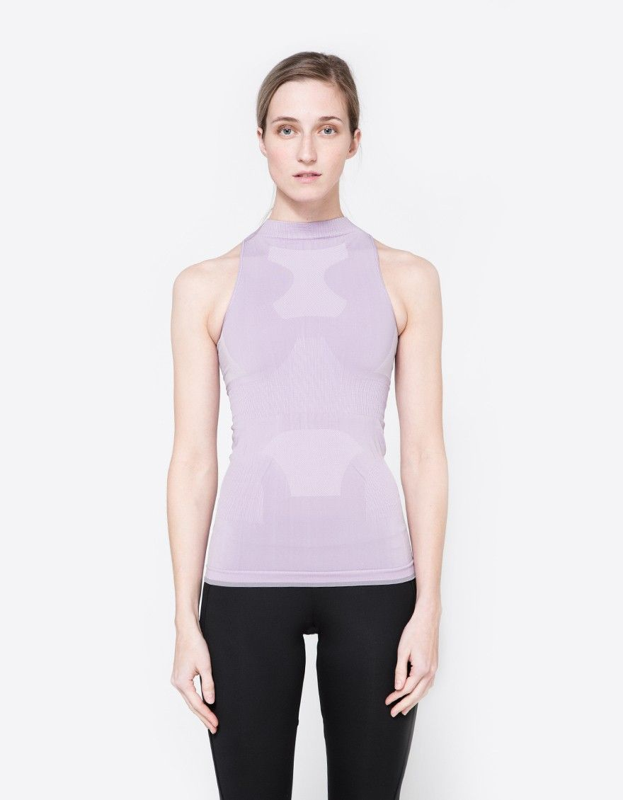Athletic tank from Adidas by Stella McCartney. Structured seamless knit fabric. Mock neckline. Racerback design. Ventilating mesh panels. Supportive inner bra. Logo detailing at lower back. Tight fit.  • Climalite® fabric • 92% nylon, 7% elastane, 1% p