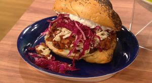 The 7-Hour Smoked Brisket Sandwich with Smoky BBQ Sauce, Sharp Cheddar, Red Cabbage Slaw, and Horseradish Sauce