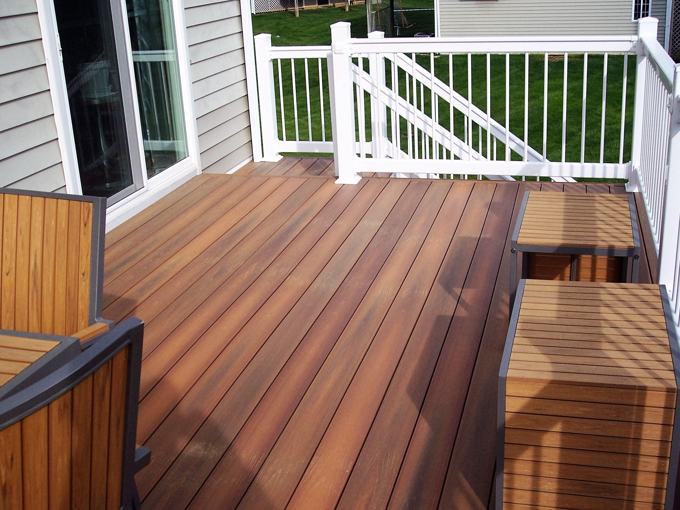 Fiberon ipe decking with white vinyl rails decks for Fiberon ipe decking prices