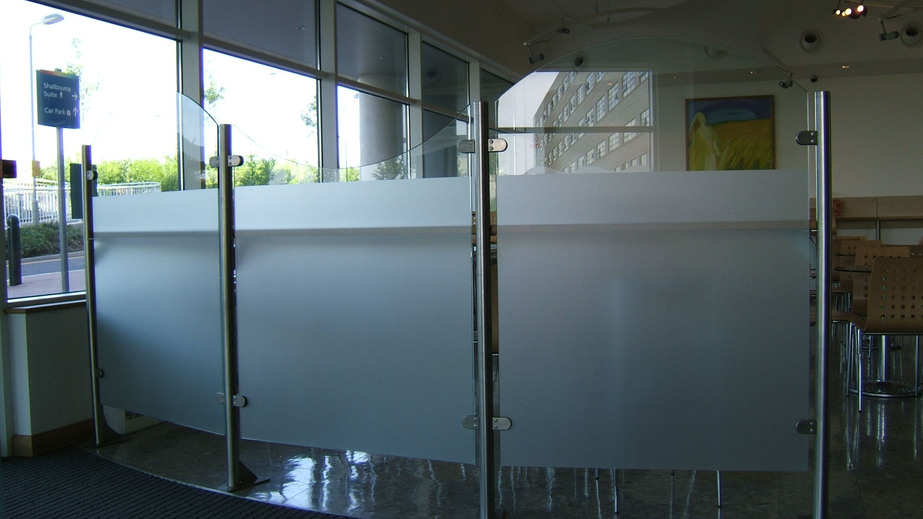 Linked glass screens. Shown here with waved tops and a