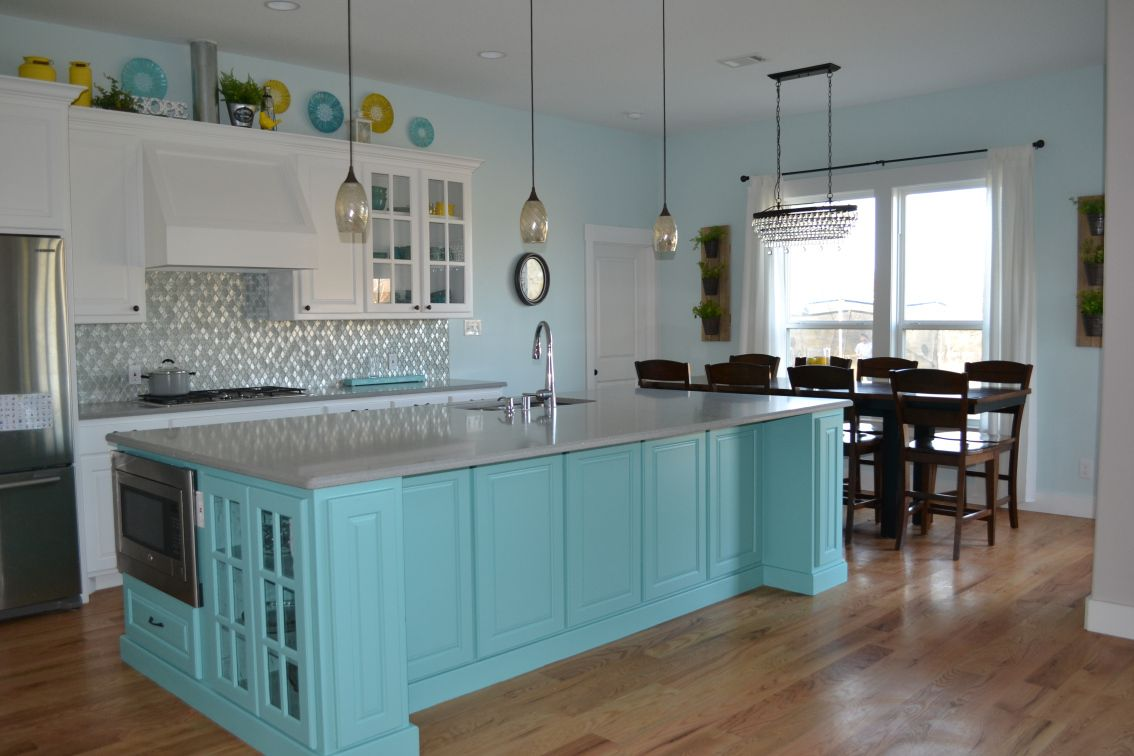 White Kitchen Cabinets With Teal Island Grey Quartz Countertops Antique Bronze Light Fixtures And