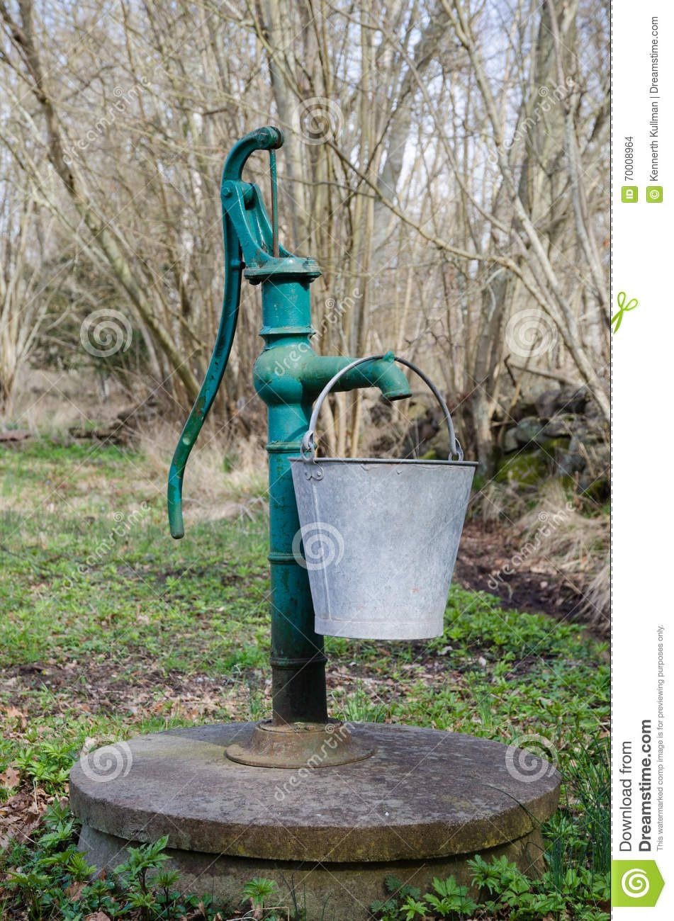 Hand Water Pump With Bucket Stock