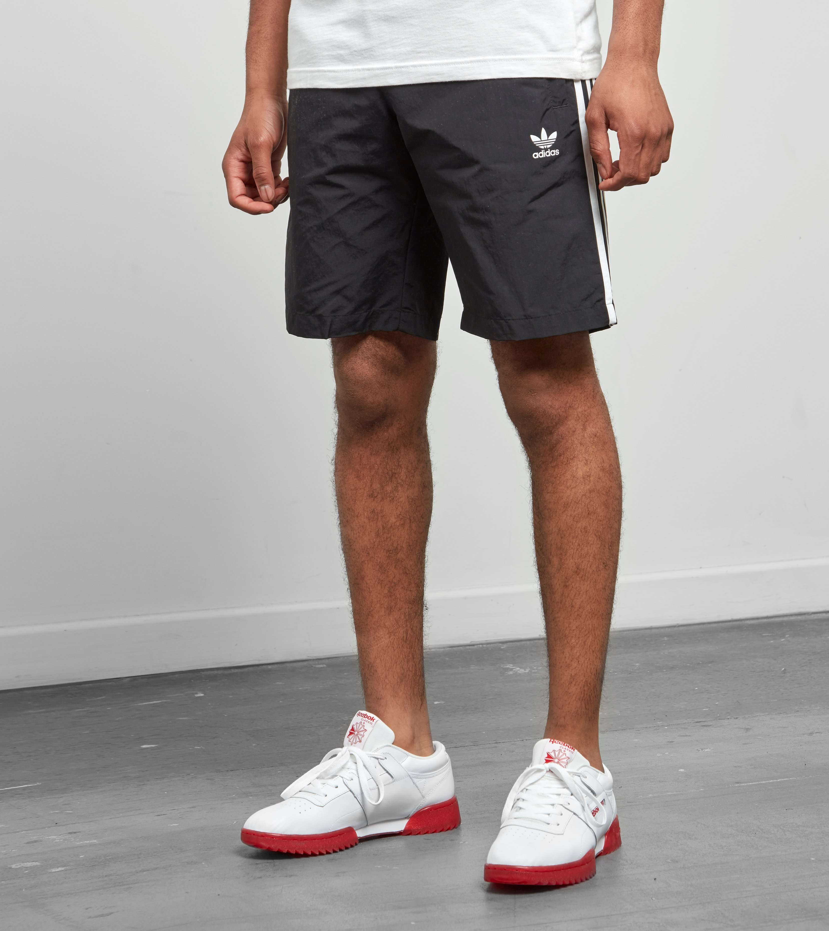 cdd3ad0edb8f0 adidas Originals 3 Stripe Swim Shorts - find out more on our site. Find the  freshest in trainers and clothing online now.