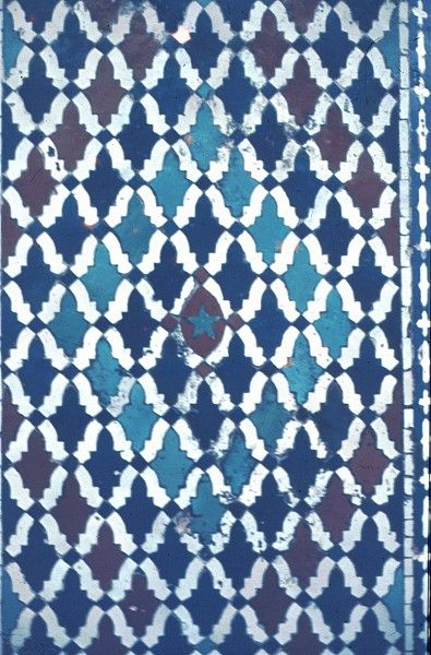 Image MOR 0903 featuring decorated area from the Bou Inaniya Medersa/Mosque, in Meknes, Morocco, showing Geometric Pattern using ceramic tiles, mosaic or pottery.