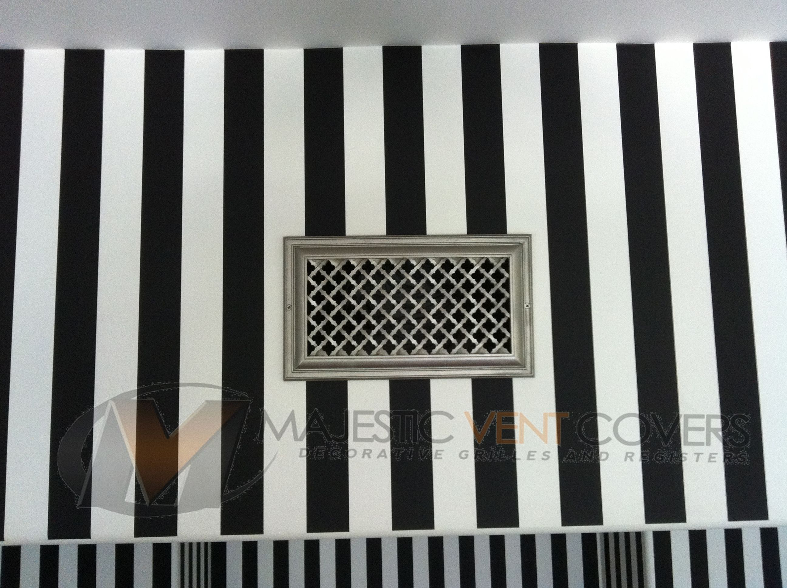 Ribbon grille on black and white striped wallpaper