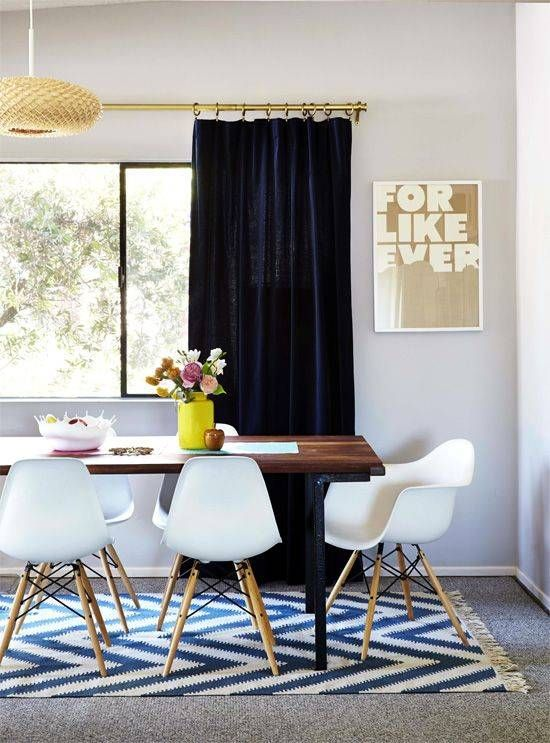 Break Up Beige With These 11 Tips To Style Rugs Over Carpet Dining Room Rug Carpet Dining Room Stylish Dining Room
