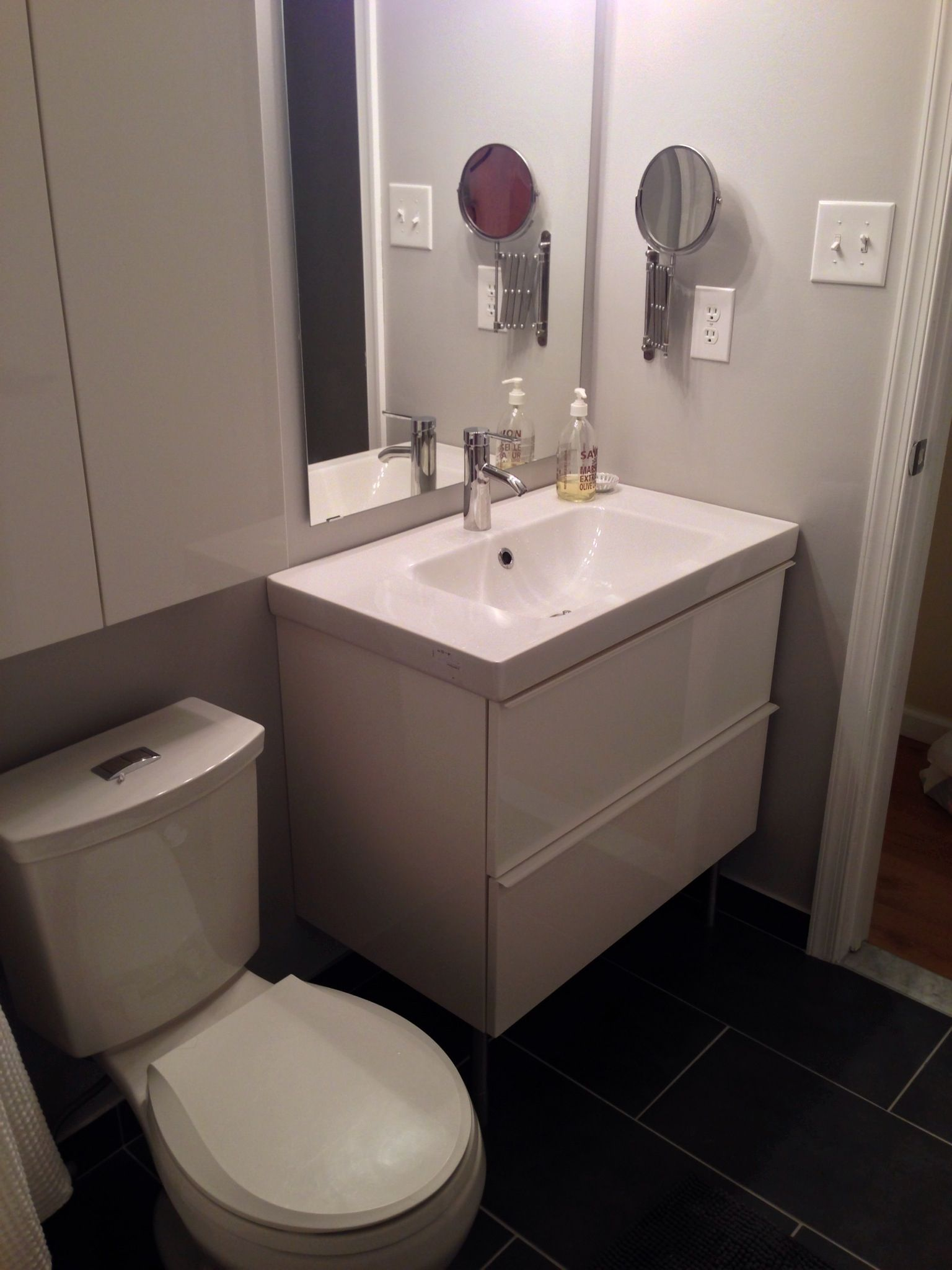 Bathroom cabinets over sink - Terrific Ikea Bathroom Vanity Sink Under Wall Mounted Swing Arm Mirror Alongside Kohler Floor Mounted Water Closet Above Black Ceramic Tile For Bathroom