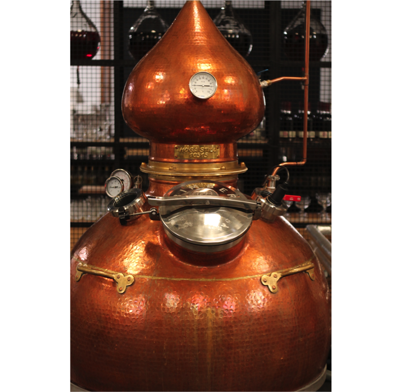 Take a look at our stunning copper still – used to create the best London dry gin from an old English recipe. That's the equation we go for. A traditional recipe + an old-fashioned still = the best test gin we could ever hope for. Doesn't it look magnificent? (The gin tastes magnificent too!)