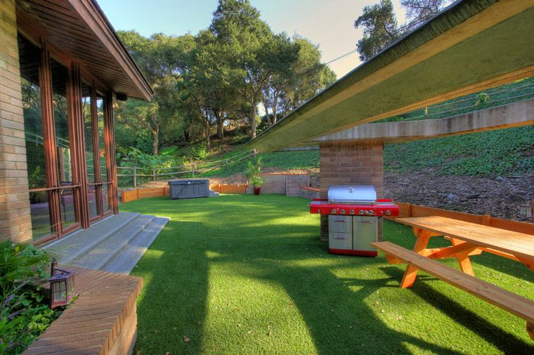 Private Hope Ranch Contemporary Back yard BBQ area. Fore