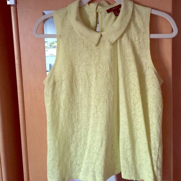 Lime Green Peter Pan Collar Lace Tank Top Super cute lime green/ chartreuse lace tank top with Peter Pan collar and button closure. Color is hard to see in photos but it's more neon than the photos. Pairs well with any outfit! Small hole on the lower right side, can be fixed easily and otherwise is in great condition!Questions and bundles welcome! Price is not firm so make me a reasonable offer! Forever 21 Tops Tank Tops