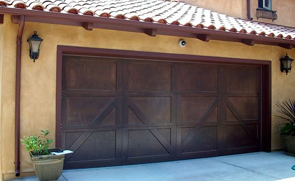 Doortec Garage Doors 9700 Series Charleston Steel Carriage Door With A  Walnut Stain,