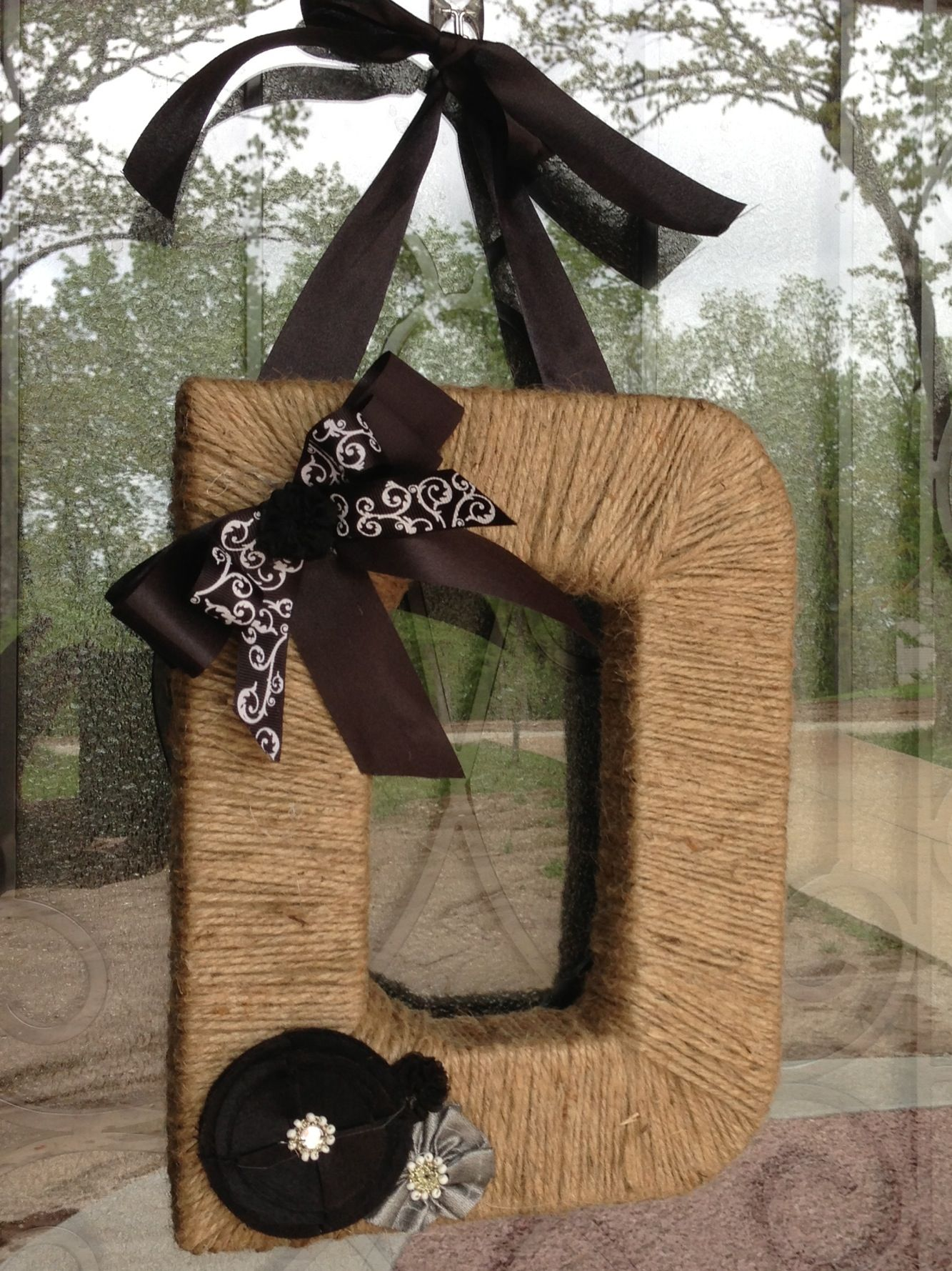 Cardboard letter bought at hobby lobby and wrapped in twine!