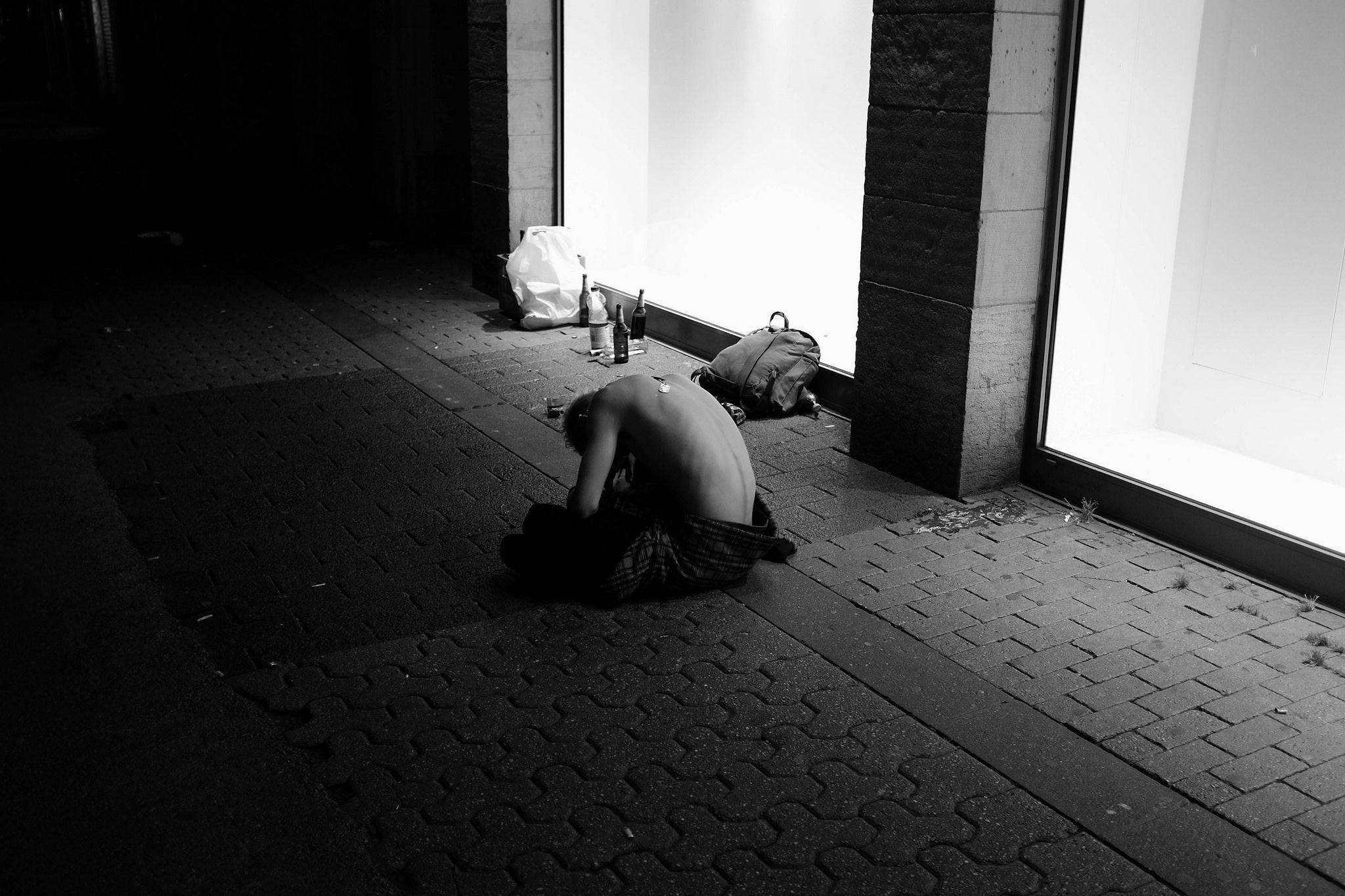 https://flic.kr/p/wMMwXk | Half Naked Sleeping Man in Düsseldorf. #streetphotography #street #photography #blackandwhite #photo