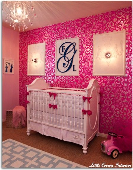 Pink nursery with hot pink damask wallpaper and a crystal chandelier ...