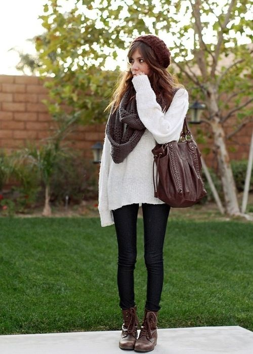 Loose knitted sweater, combat boots and a chunky scarf.