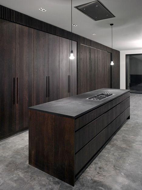 Kitchen in dark oak and concrete by John Smart Architects.: