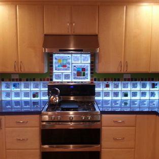 Glass Tile Blocks for Backsplashes, Shower Walls & Windows - This kitchen backsplash using glass blocks that have art glass tiles fused to t...