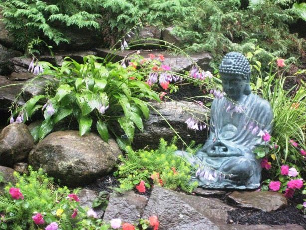 buddha gardens down in the rain the hosta places its flowers in the buddhas lap - Buddha Garden