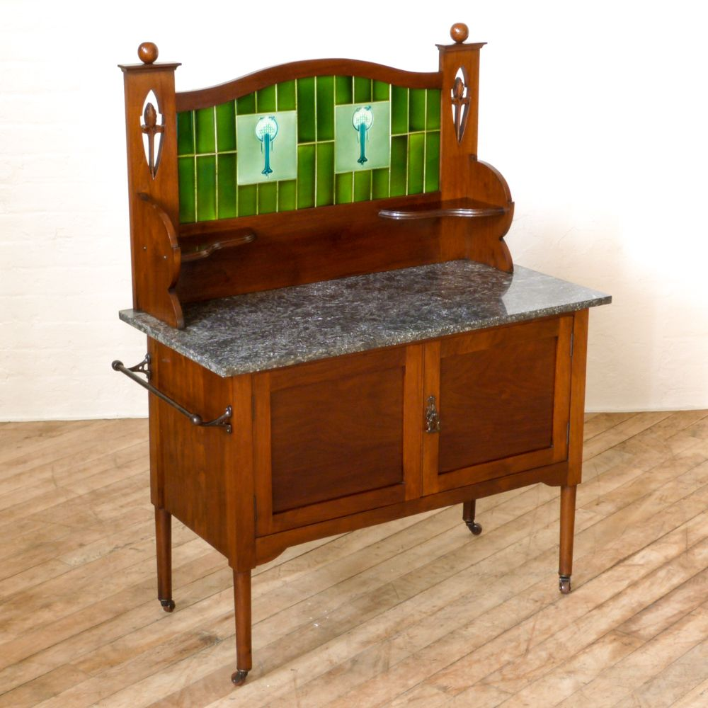 A victorian walnut washstand with beautiful green tiles