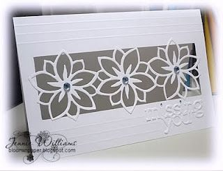 "lacey flower die cuts form a ""grill"" over an aperature...luv this card!!"