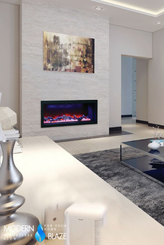 Amazing colorful built-in electric fireplace. Can be installed virtually anywhere. Flame operates with or without heat. Comes with remote control. #modernfireplaceideas