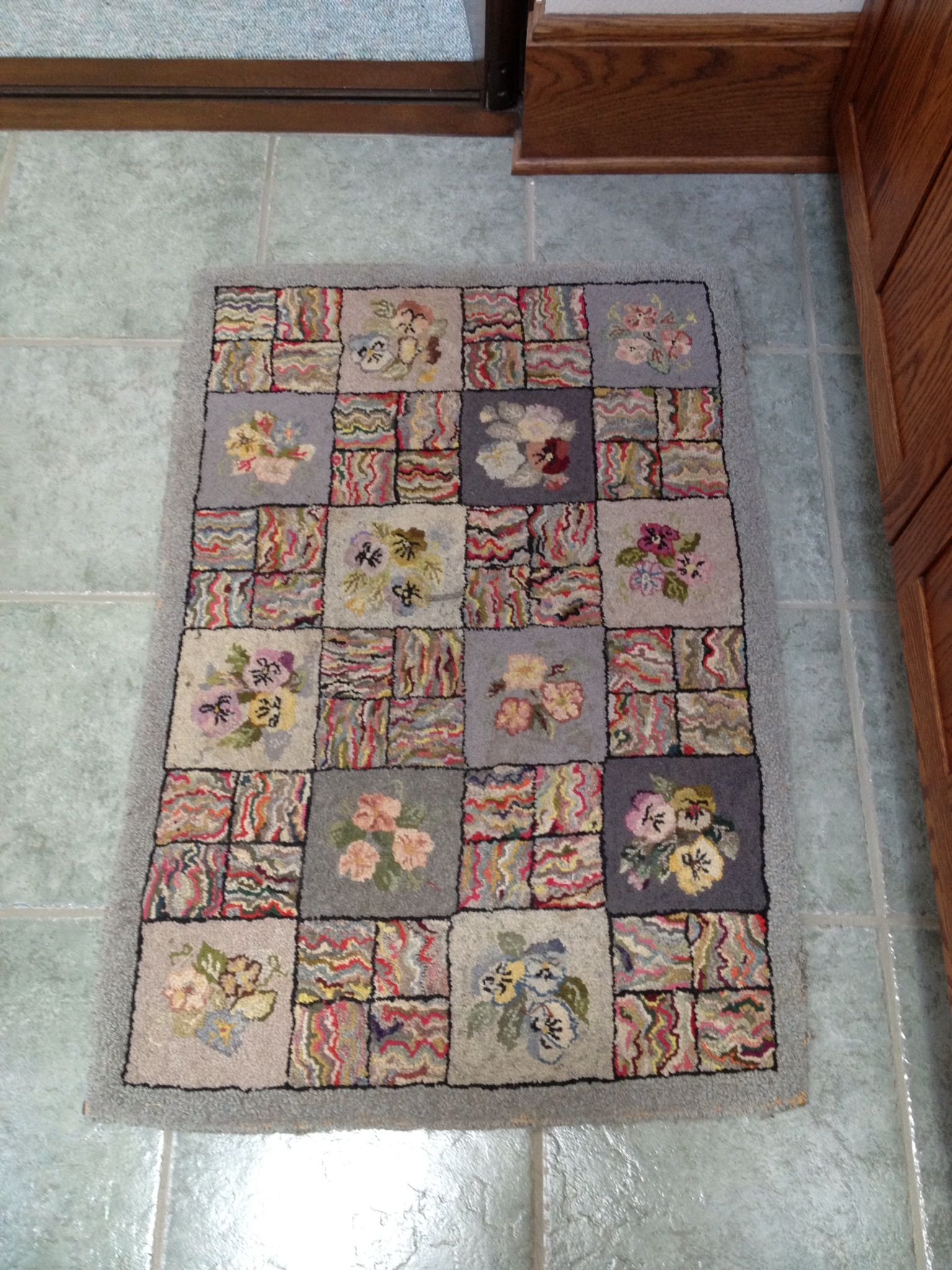 Antique hooked rug - love pansies AND hit and miss!