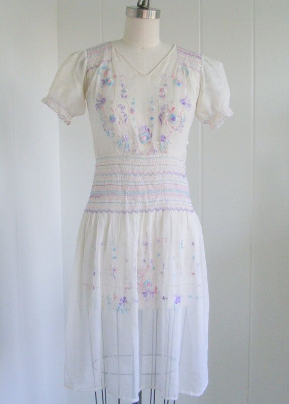 From the sort springtime pastel hues of the embroidery to the airy, summertime perfect lightweight fabric, there's much to adore about this vintage 1920s boho-esque dress. #vintage #1920s #1930s #1940s #dress #boho #summer #embroidery