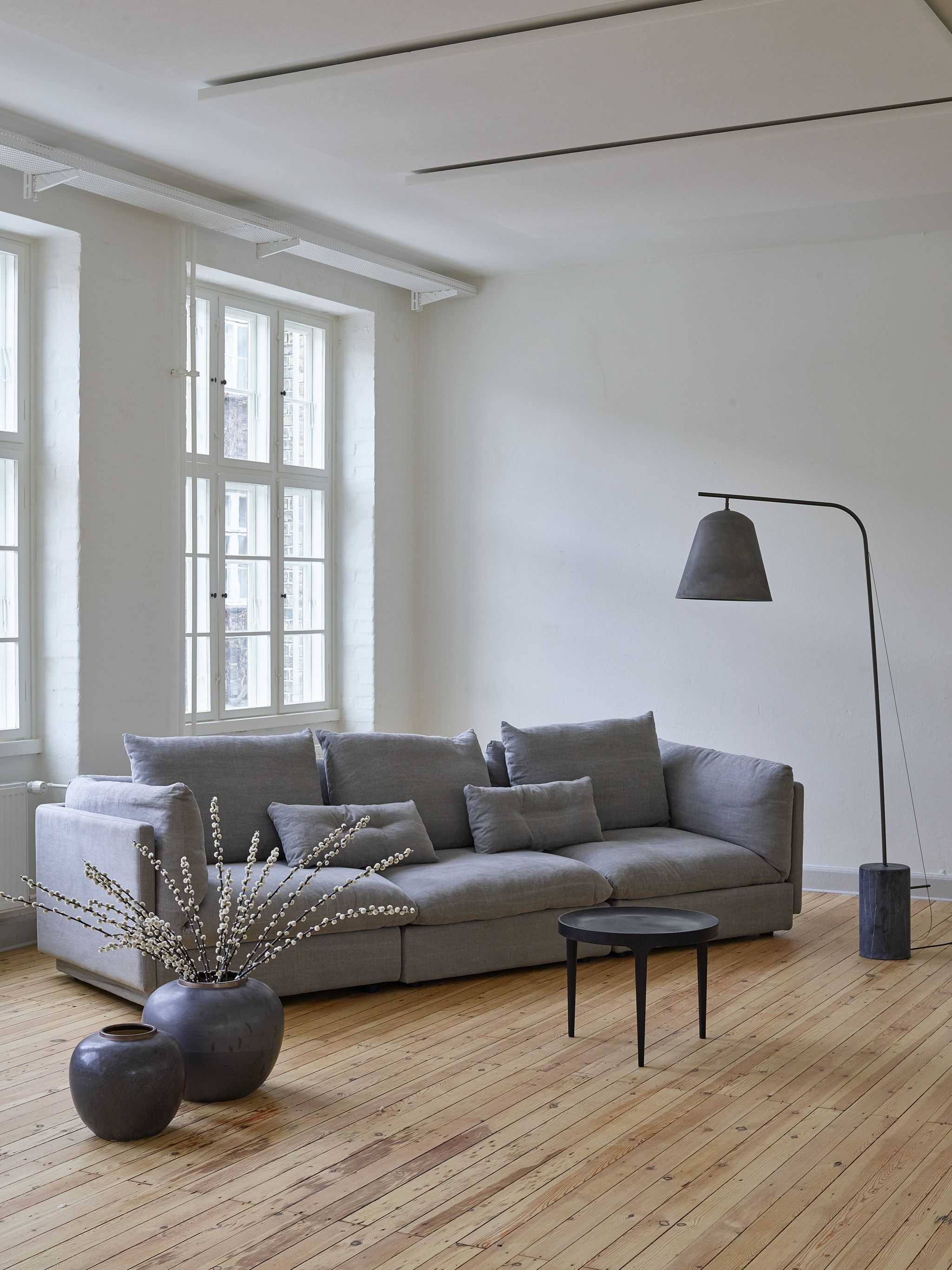 The Macchiato Sofa Ghost Coffee Table and the Line Two lamp in