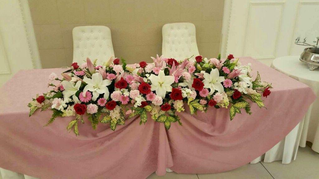 ピンクの濃淡とカサブランカを使用した会場装花   NKフラワー