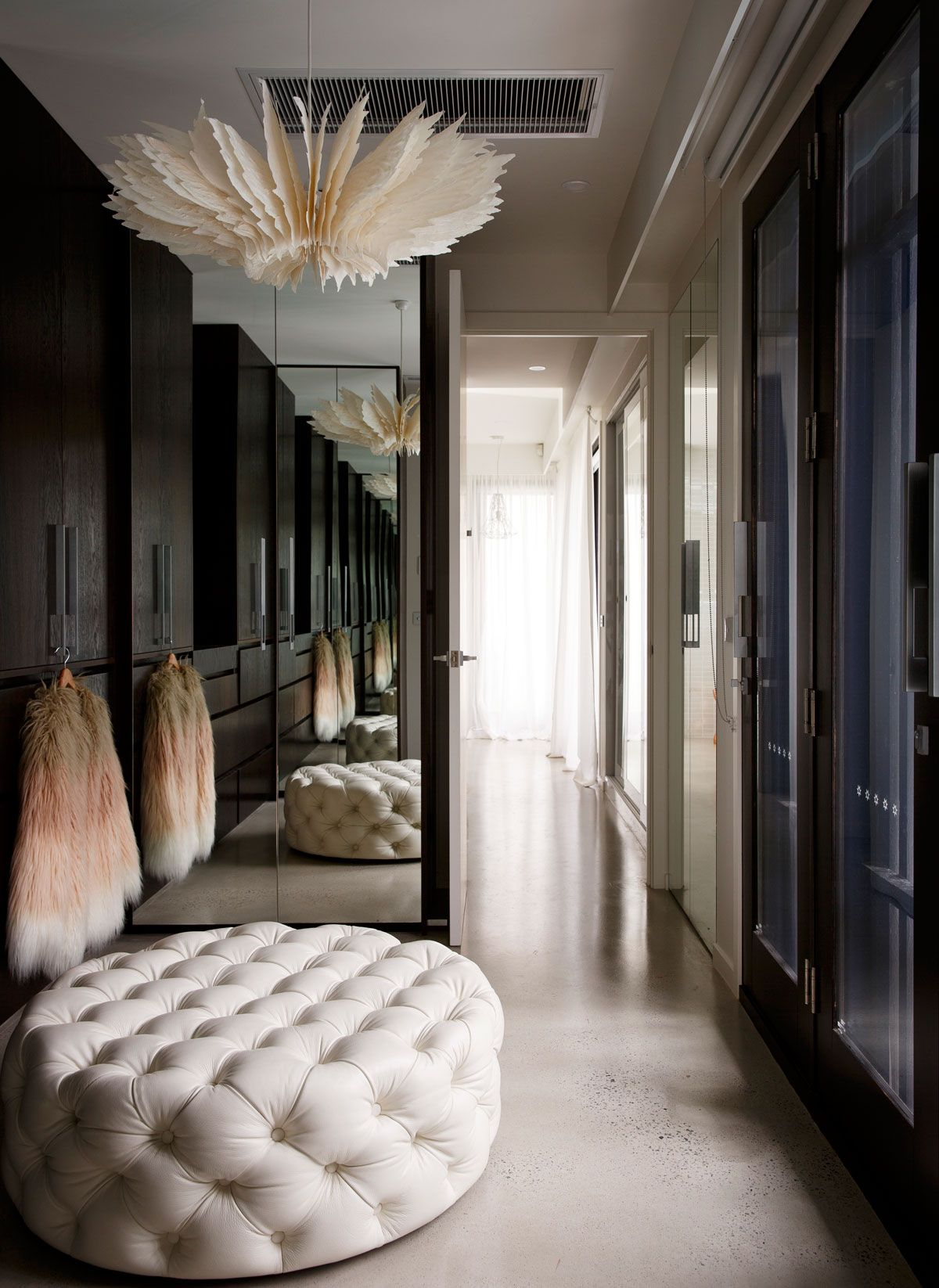 Bec Judd S Dreamy Walk In Closet Complete With Tufted Ottoman And Polished Concrete Floors That Light Fixture