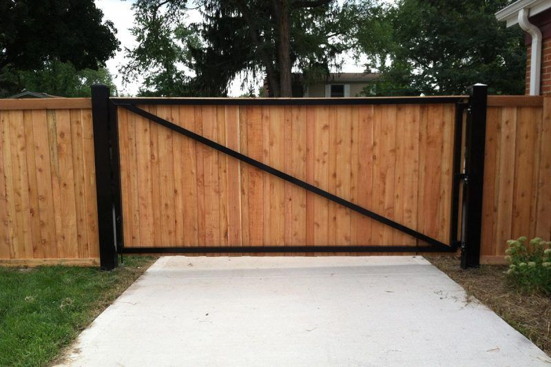 Back Side Of A Drive Gate Metal Frame Wood Slats Fence