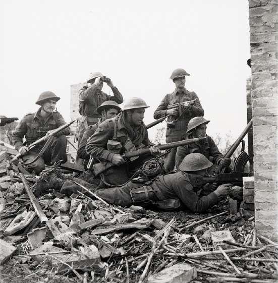 Canadian 48th Highlanders infantry regiment in Italy, 10 Dec 1943; the man with binoculars was Platoon Commander Mcdonald.
