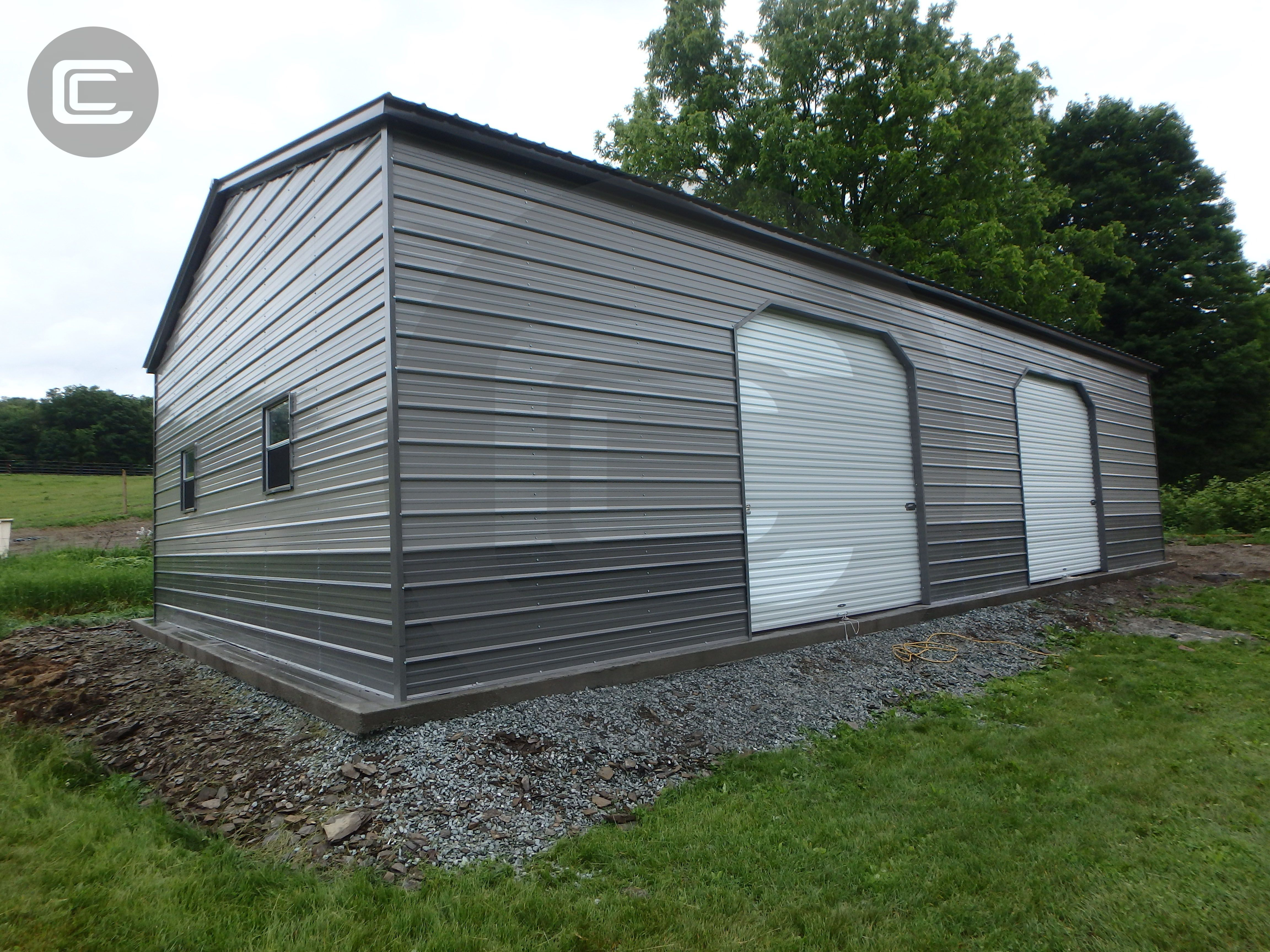 Carport Central's Install of the week is this two-tone metal garage. This structure has two side entries, and features a vertical roof. The actual measurements of this garage are 30'W x 40'L x 12'H and includes two 45-degree cut 10'x10' roll-up garage doors and two windows on the end wall. To get a building fully customized, give us a call at 866-761-1171.   #Garage #MetalStructure #CarportCentral #Customizable #BBBTorchAwardWinner #Fast50