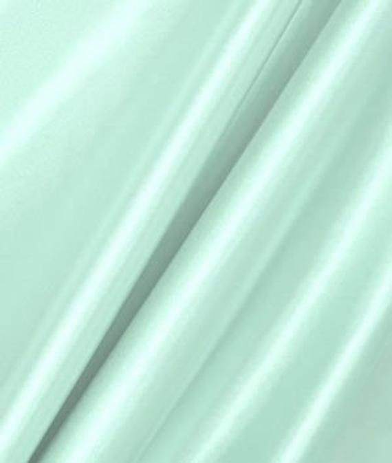 Fresh Mint Green Quality thick Satin Fabric available for purchase by the yard, half yard, quarter yard. Measurements 60