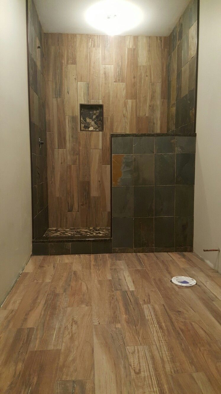 faux wood tile as an accent wall in shower slate stone on surrounding walk in shower. Black Bedroom Furniture Sets. Home Design Ideas