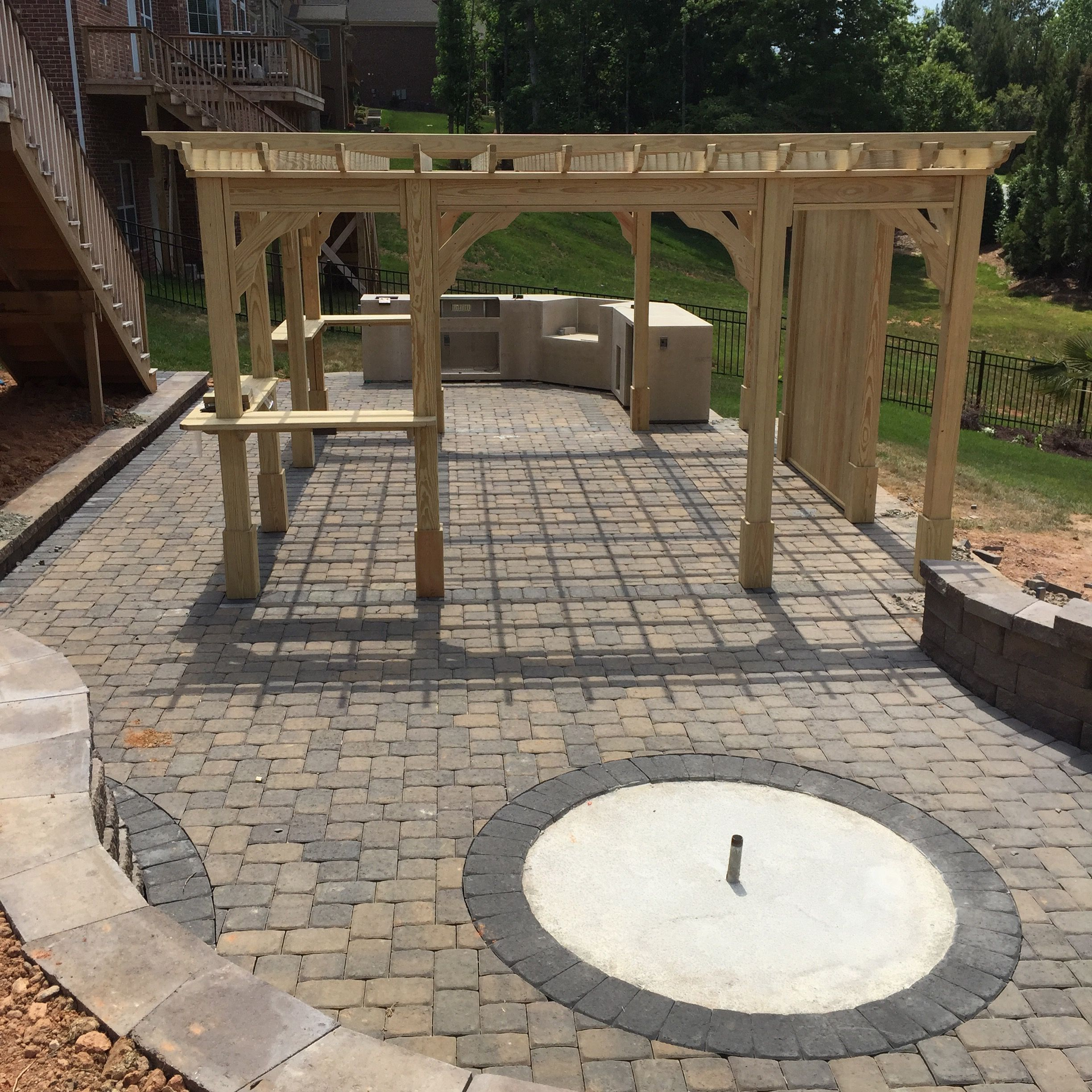 Paver patio retaining wall kitchen island have been installed