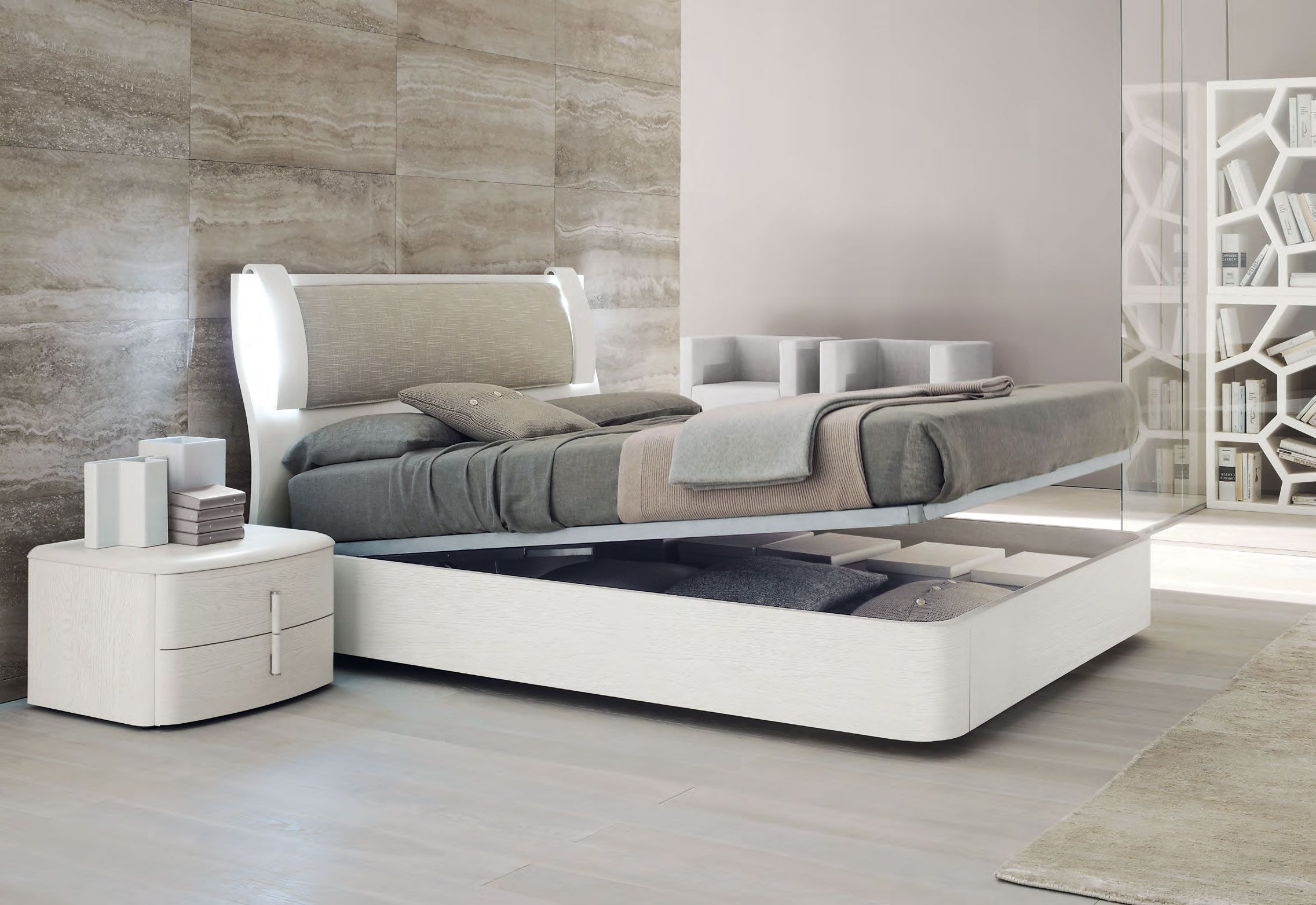 modern bedroom with white reclinig bed furnished with gray cover