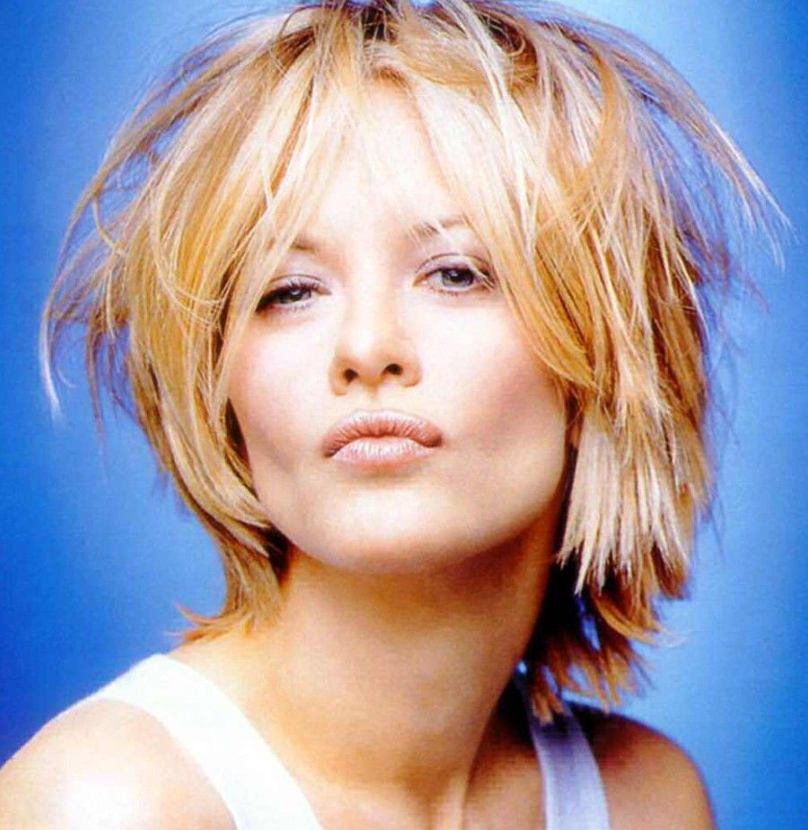 do you like Meg Ryan better with straight hair or curly