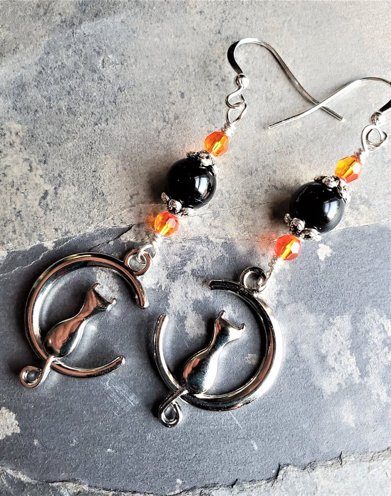 A PAIR OF TIBETAN SILVER  AND BLACK  BEAD CAT CLIP ON EARRINGS NEW.