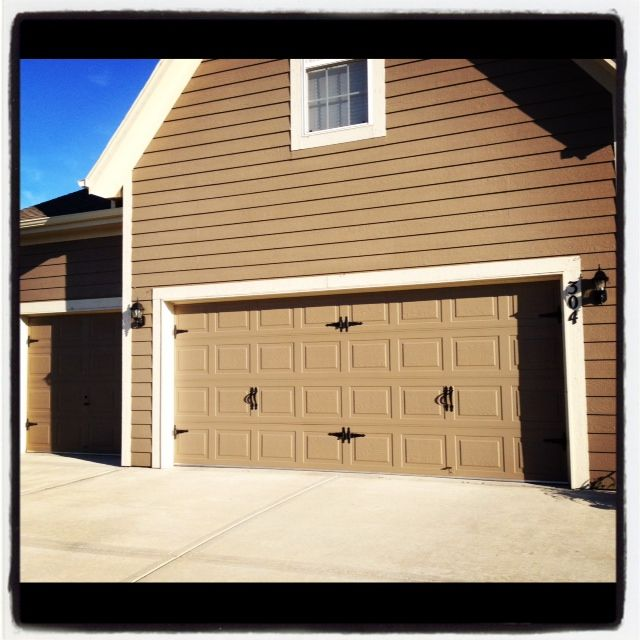 Diy Carriage Door Trim A Year Later Liquid Nails Is Holding The Hardware On Strong Carriage House Garage Doors Carriage Doors Diy House Projects