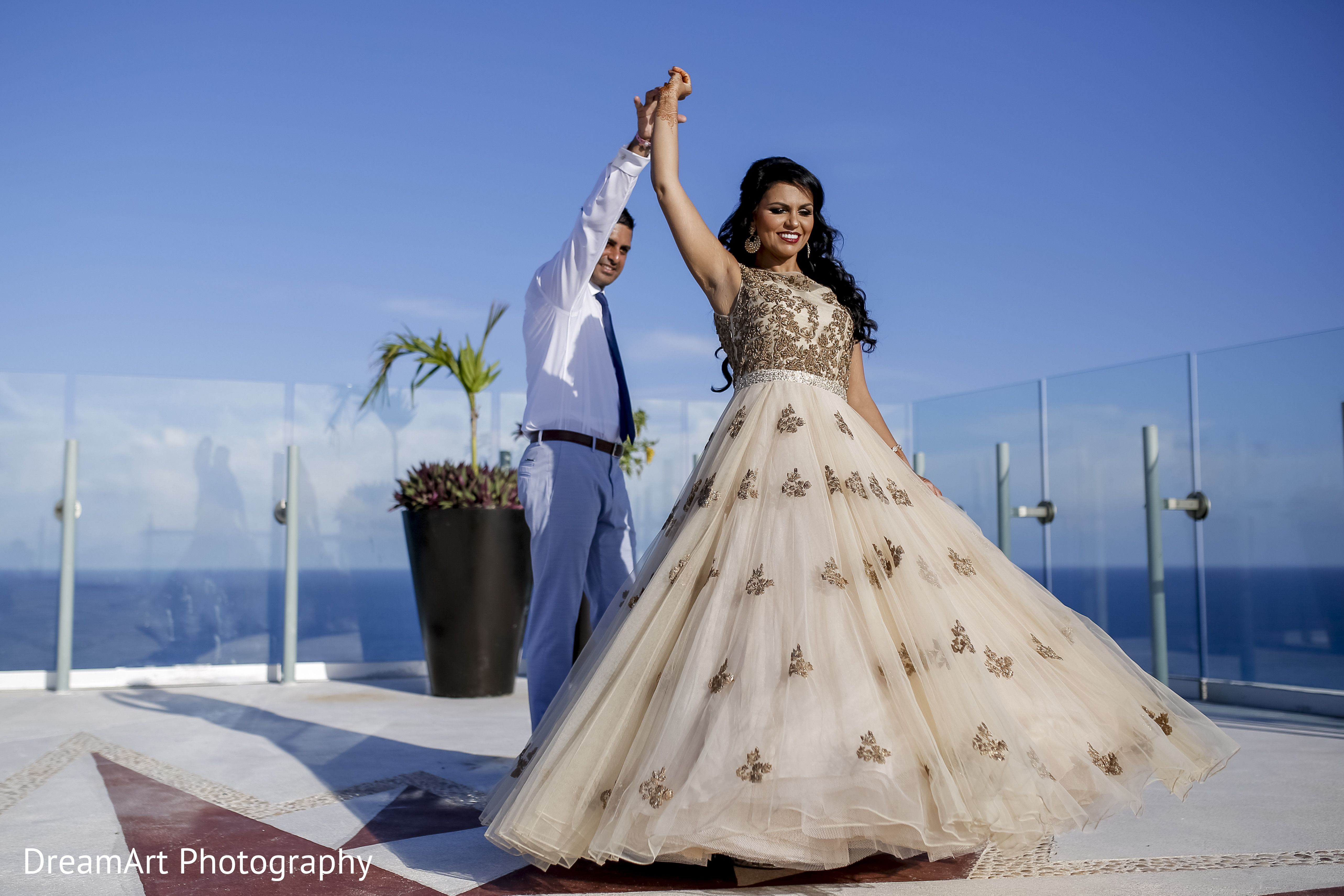 Handsome Indian groom showing off his beautiful Indian bride in ...