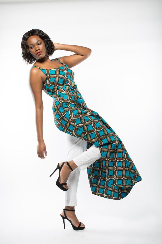 Stunning dress top with surprising back detail that will wow at any occasion. Can be worn with trousers or a fitted mid length skirt. Made to order only in 2 -3 weeks.  Full Length: 65 inches.  Colour - turquoise and brown.  Comes with its own obi belt.  MODEL: 5ft 7inches, size 10  Size conversion  UK10 - US 6 (bust 34inches, waist 28 inches) UK12 - US 8 (bust 36inches, waist 30 inches) UK14 - US 10 (bust 38inches, waist 32 inches) UK16 - US12 (bust 40 inches, waist 34 inches) UK18 - US14…