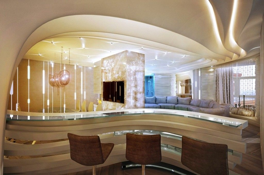 Modern curved mini bar area with brown bar stools and glaszed counter top for luxury house - Luxury home bar designs ...